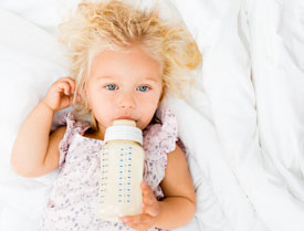 Baby using bottle - Pediatric Dentist in Oakhurst, NJ